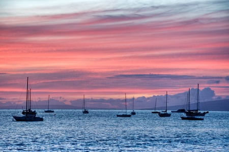 Moored sailboats under a colorful Lahaina, Maui, Hawaii sunset