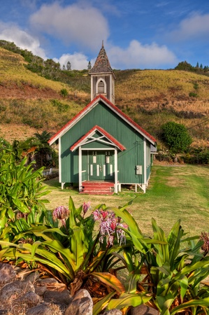 The colorful and picturesque Kahakuloa Church resides in one of the more remote villages on Maui, Hawaii