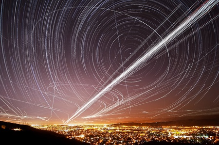 The accumulated light trails from the stars and air traffic above San Jose, California
