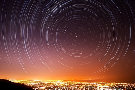 The accumulated star trails in the night sky above San Jose, California