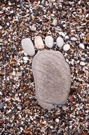A pebble footprint in the sand