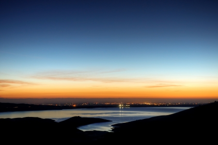 The sun rises on the San Luis Reservoir and Central Valley of California.