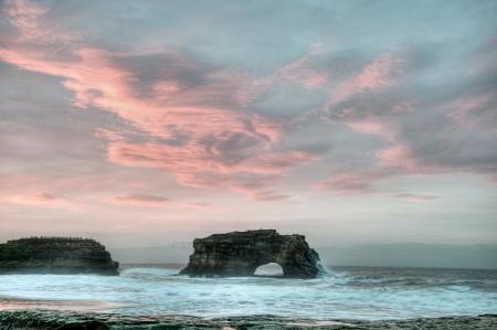 california beach: The sun rises on the beautiful coastline of Natural Bridges State Beach, Santa Cruz, California.