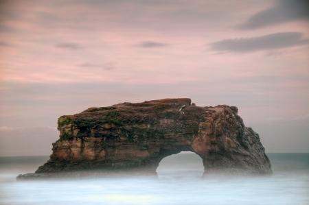 The sun rises on the beautiful coastline of Natural Bridges State Beach, Santa Cruz, California.
