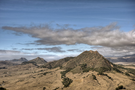 Four of the nine sister peaks in the Morros of San Luis Obispo County under an autumn sky. Stock Photo