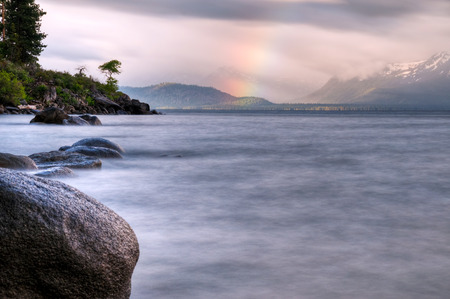 A long exposure of a rainbow over Lake Tahoe