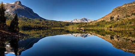 A panoramic reflection of Mammoth Peak and the Kuna Crest on Tioga Lake, Yosemite National Park, California