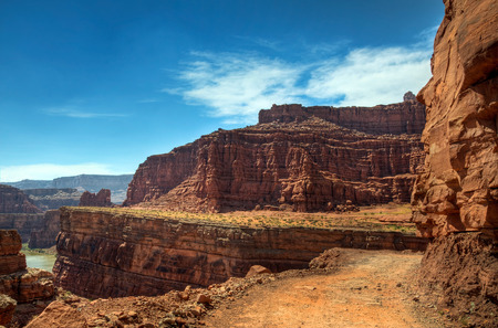 The Schafer Basin Trail has dangerous sections with narrow passages and sheer cliffs dropping into deep canyons, Canyonlands National Park, Utah  Stock Photo
