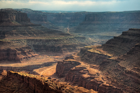 The Shafer Basin Trail traverses and then climbs the canyon walls with switchbacks leading to the Island in the Sky, Canyonlands National Park, Utah  Stock Photo