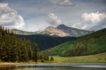 Italian Mountain stands tall above the Spring Creek Reservoir, Colorado;