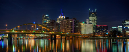 A panorama of downtown Pittsburgh, Pennsylvania at night from the North Shore