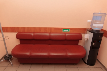 Cooler for water cooling near a brown sofa located indoors  Stock Photo - 20360932