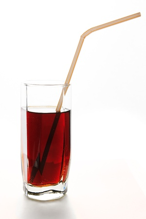 refreshing red drink in a glass with straw for cocktails photo