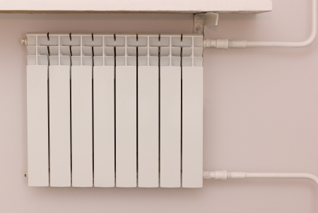 new radiator with hot water for room heating photo