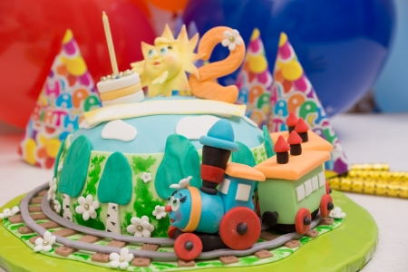 childs birthday party: beautiful cake with a fabulous train and other decorations