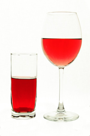 thirsting: glass and wine glass with red liquid