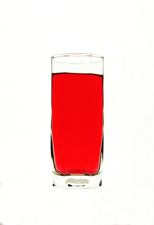 thirsting: glass  with red liquid