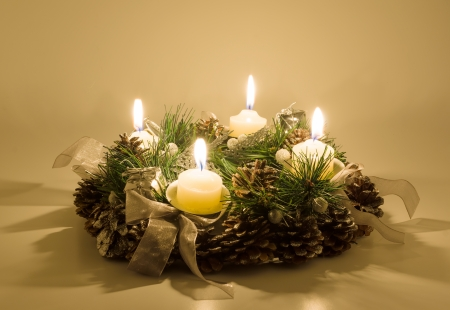 Christmas wreath of pine branches and cones with candles  photo