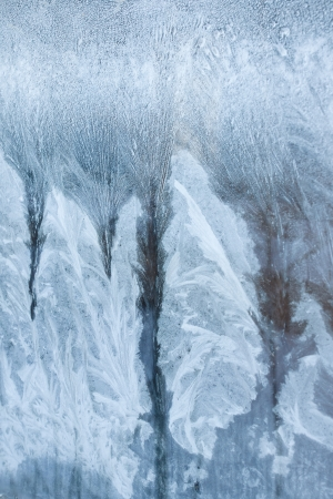 icey: view of the street through the frozen window with frosty patterns Stock Photo