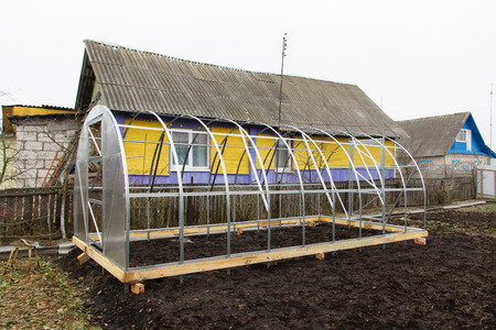 laths: the greenhouse made of metal laths and transparent plastic Stock Photo