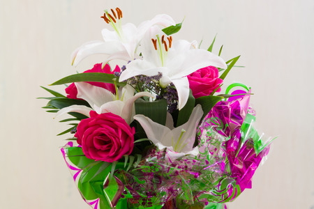 fine bouquet from fresh lilies and roses as a gift photo