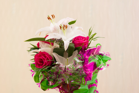 aciculum: fine bouquet from fresh lilies and roses as a gift