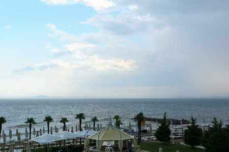 the cloudy sky and the coastline before an approaching storm photo