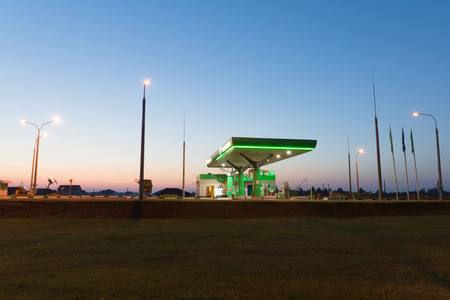 gas station under the night sky is shined with artificial lamps Editorial