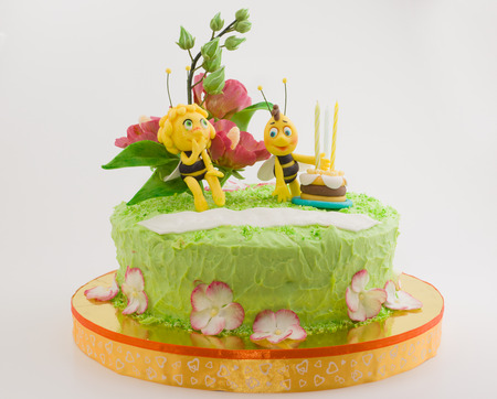 childs birthday party: beautiful cake with a fabulous bee and other decorations Stock Photo