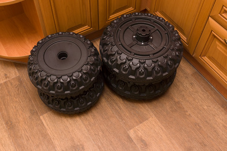 four black wheels from a small sports car photo