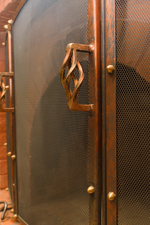 the copper chimney lattice with the beautiful handle serves as protection against fire photo