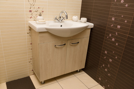 washstand: new bathroom with a white washstand and the chromeplated cranes