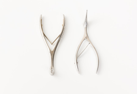 chromeplated: some chromeplated medical surgical tools lie on a white background