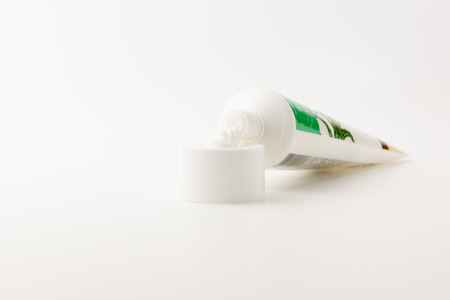 sooth: tube with a small amount of the squeezed out white cream