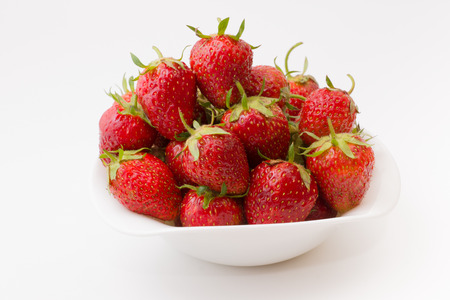 bowl full of ripe juicy strawberry on a white background photo