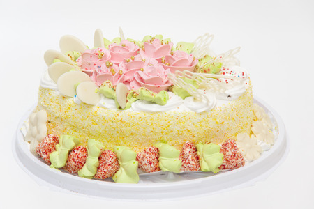 the big sweet pie decorated with cream roses on white background photo
