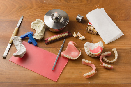 prosthodontics: place of work of the dental technician with a set of tools necessary for work