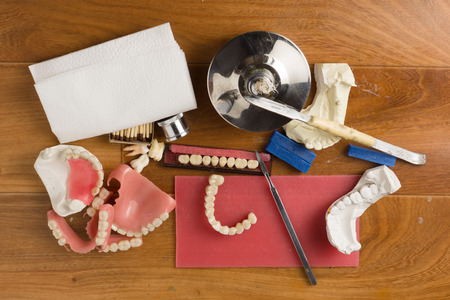 dentures: place of work of the dental technician with a set of tools necessary for work