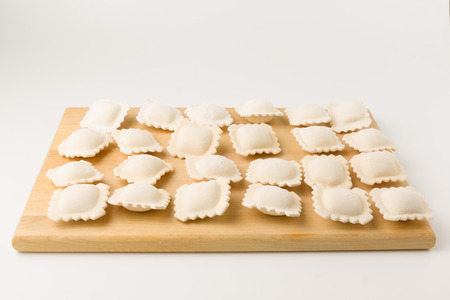 in the ranks: frozen a dumpling are laid out by equal ranks on a board