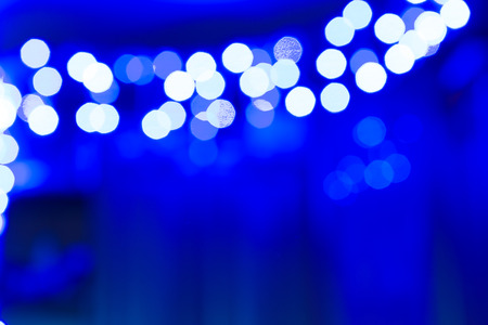 blinking: garland lights lit on a blue background and creates a holiday Stock Photo
