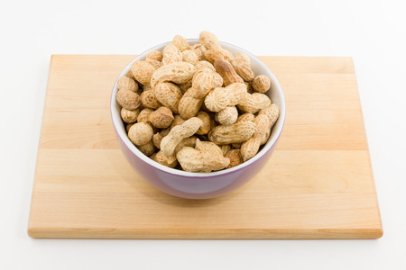 plateful: the plateful of a peanut costs on a plate on a white background