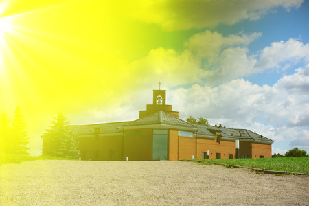 christian trust: cathedral of Franciscans from a red brick under the blue sky with white clouds Stock Photo