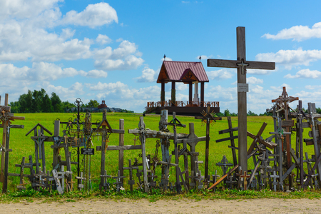 generic location: Set of crucifixions and crosses with a religious arbor behind them