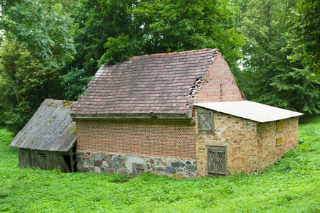 restauration: ancient construction from a brick in the wood serving in olden days as storage for products