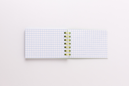 sharp pencil: notepad on a white background with a sharp pencil