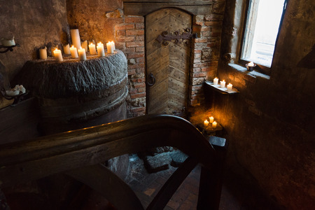 fermenting: the cellar with the burning candle is located in an ancient tavern
