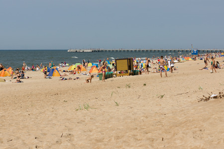 baltic people: PALANGA, LITHUANIA - AUGUST 02: Affluence of holidaymakers to Palanga beach on August 02, 2015 in Palanga, Lithuania. About 1 million people visited Baltic coast over the weekend.