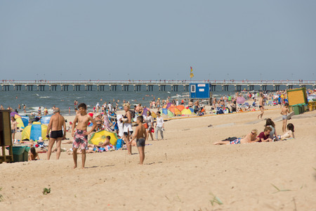 affluence: PALANGA, LITHUANIA - AUGUST 02: Affluence of holidaymakers to Palanga beach on August 02, 2015 in Palanga, Lithuania. About 1 million people visited Baltic coast over the weekend.
