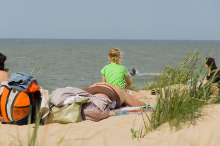 rive: PALANGA, LITHUANIA - AUGUST 02: Affluence of holidaymakers to Palanga beach on August 02, 2015 in Palanga, Lithuania. About 1 million people visited Baltic coast over the weekend.