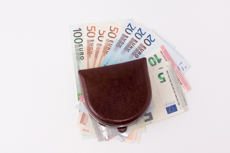 looting: the brown leather purse with banknotes